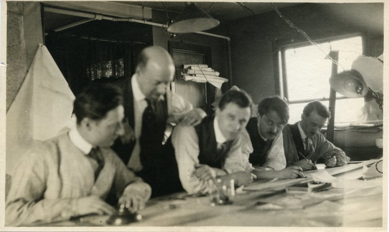 Five Men at Drawing Table
